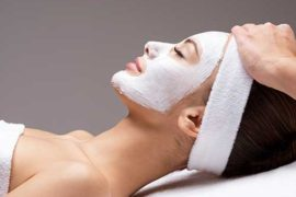 spa-massage-for-woman-with-facial-mask-on-face-FNAEJU3